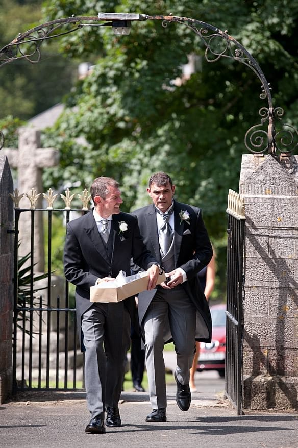 groomsmen heading in to st mary's church in plymouth