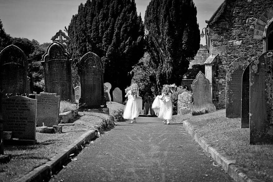 flowers girls running to the front door at st mary's church in plymouth