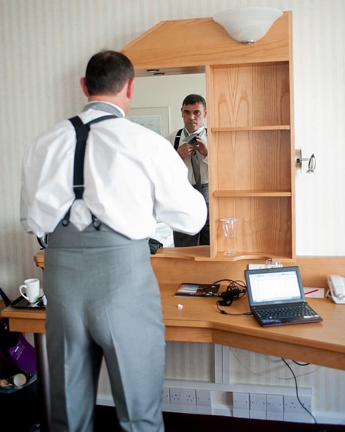 grooms getting ready in the hotel before a wedding at Crownhill fort