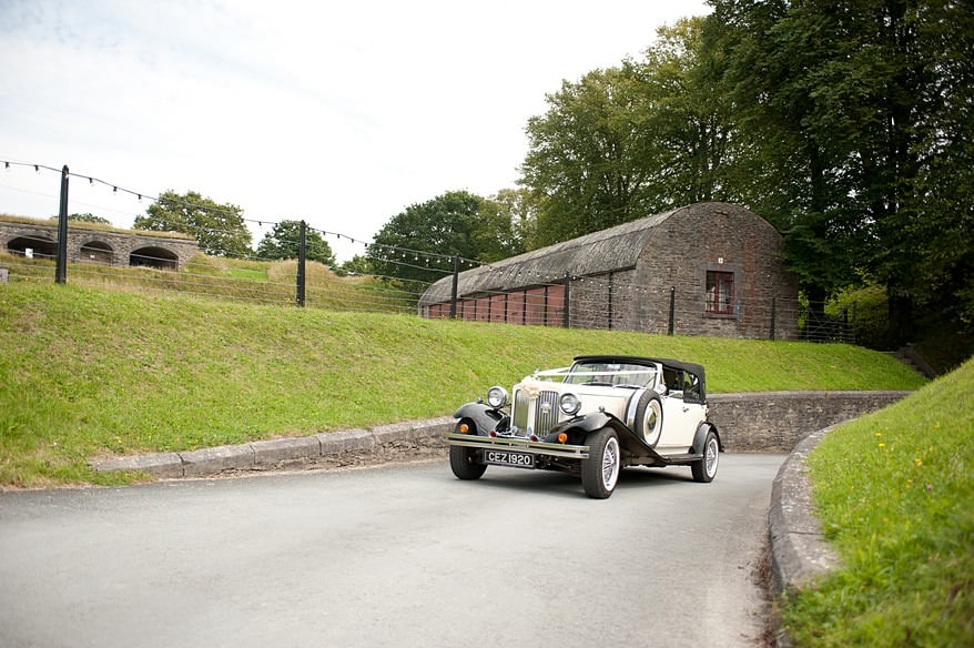 the wedding car talking the bride and groom to crownhill fort