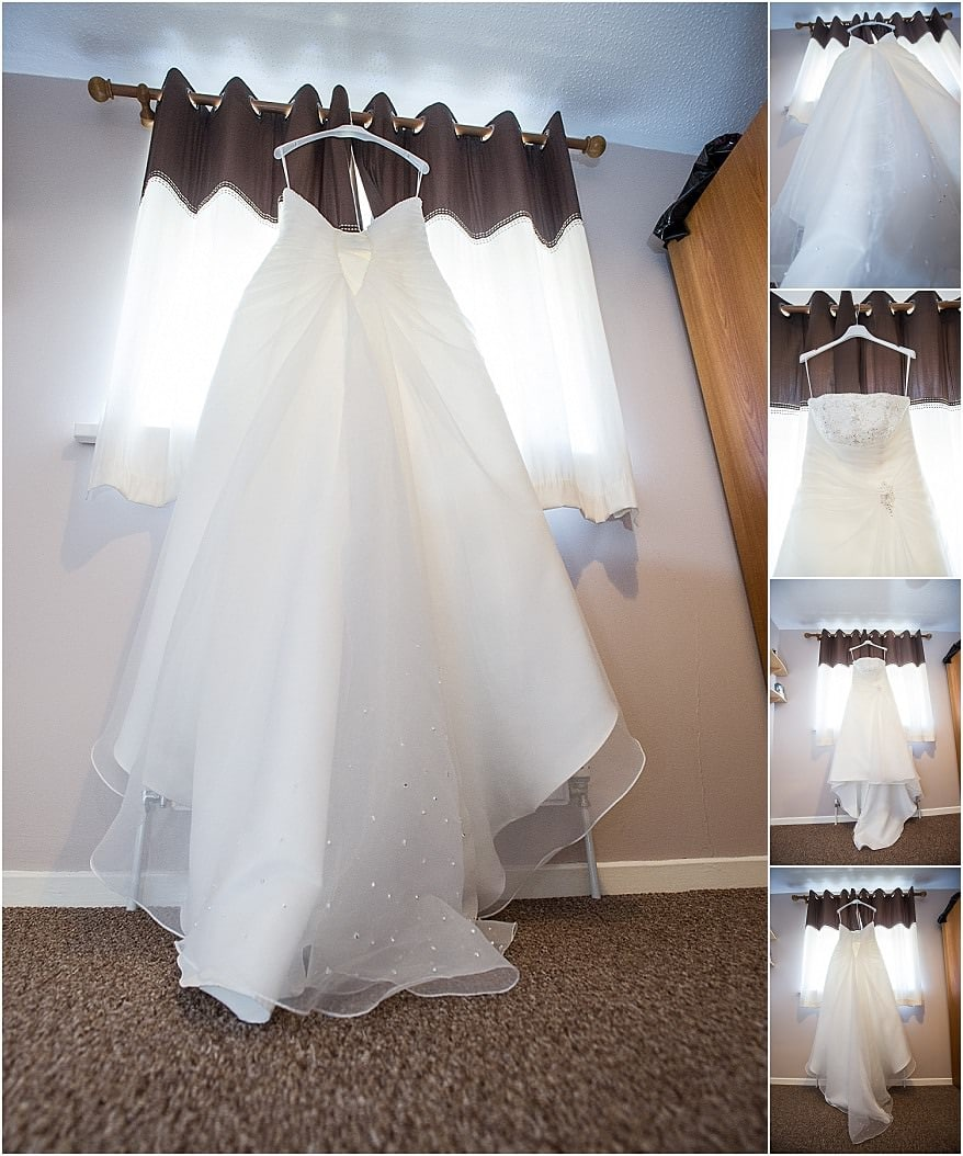 Brides wedding dress hung up in the window