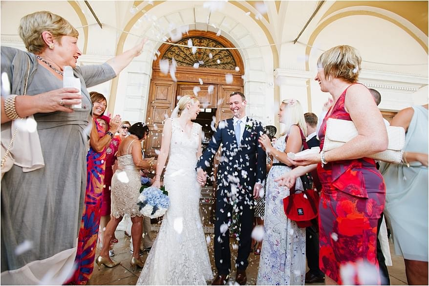 confetti bring thrown over the bride and groom in lake garda