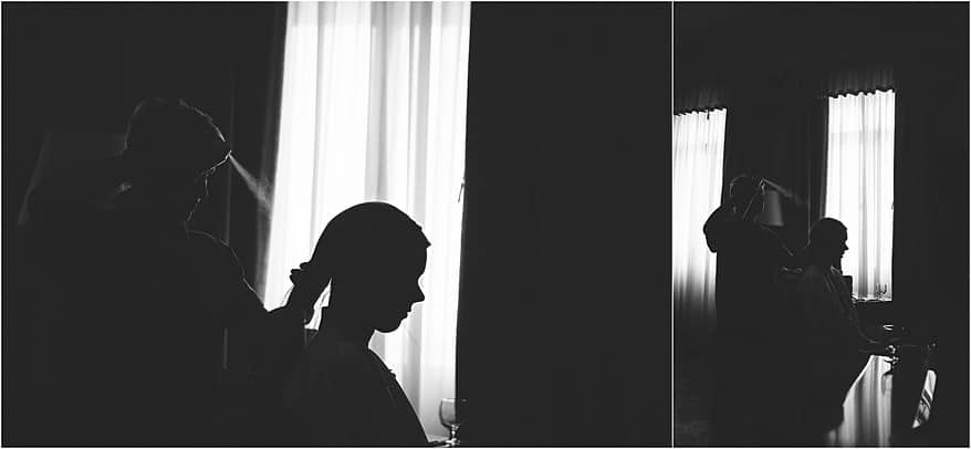 black and white picture of the bride in Lake Garda having her hair done