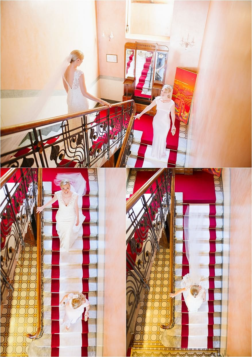 Bride walking down the stairs with her bridemaid at Hotel Laurin italy