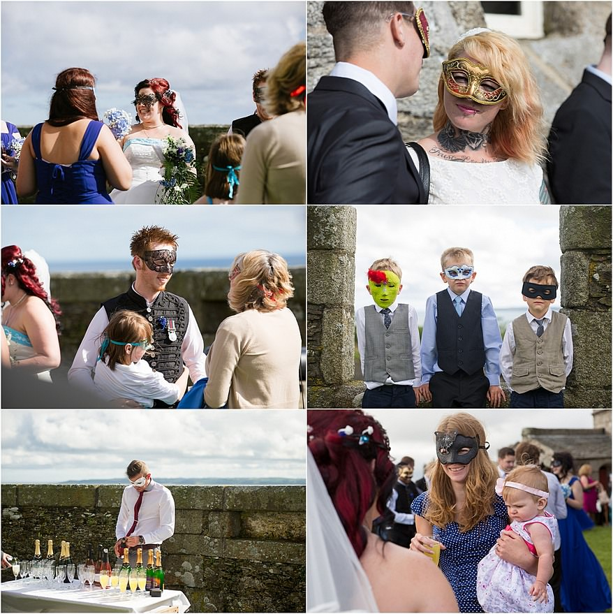 Wedding guest with masquerade masks at Pendennis castle wedding photography