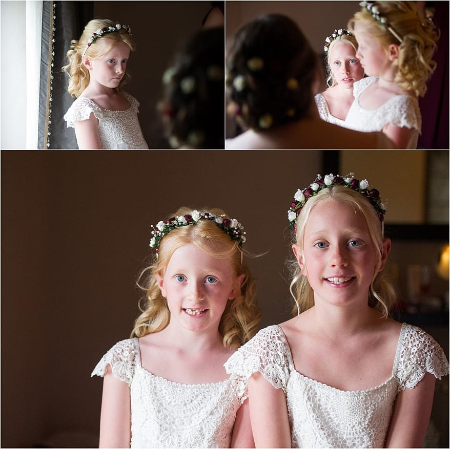 pretty flower girls smiling at the bride