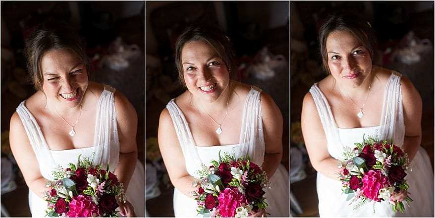 bride in beautiful window light smiling to the camera