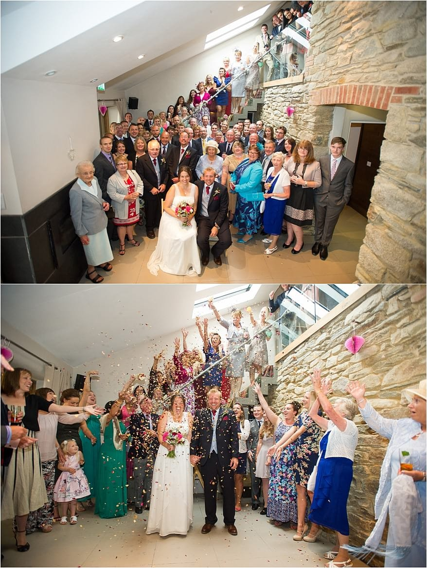 group photograph of the wedding guests inside the barn of trevenna
