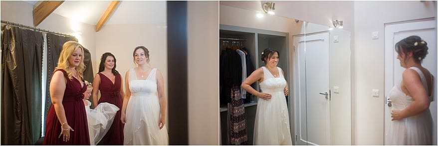 bride looking in the mirror at herself