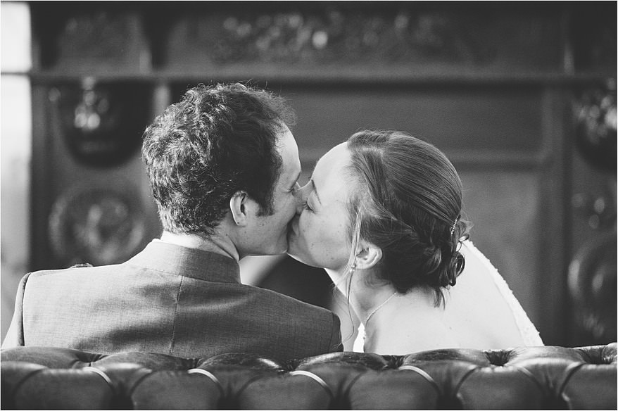 Bride and groom kissing on the sofa at their Carbis Bay Hotel Wedding
