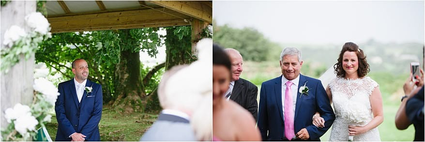 Groom smiling at the bride coming down the aisle at Trevenna Barns