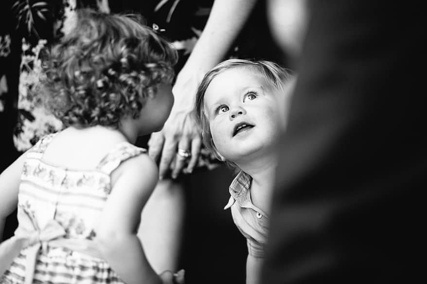 Lovely little boy looking at the groom at a Lake Garda Wedding