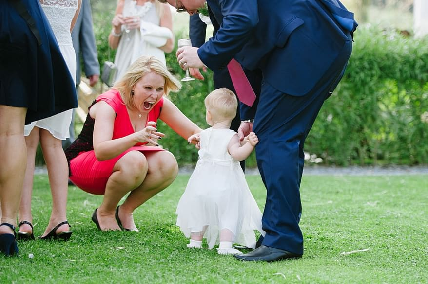 Candid shot of the guest hugging a little girl at Trevenna barns