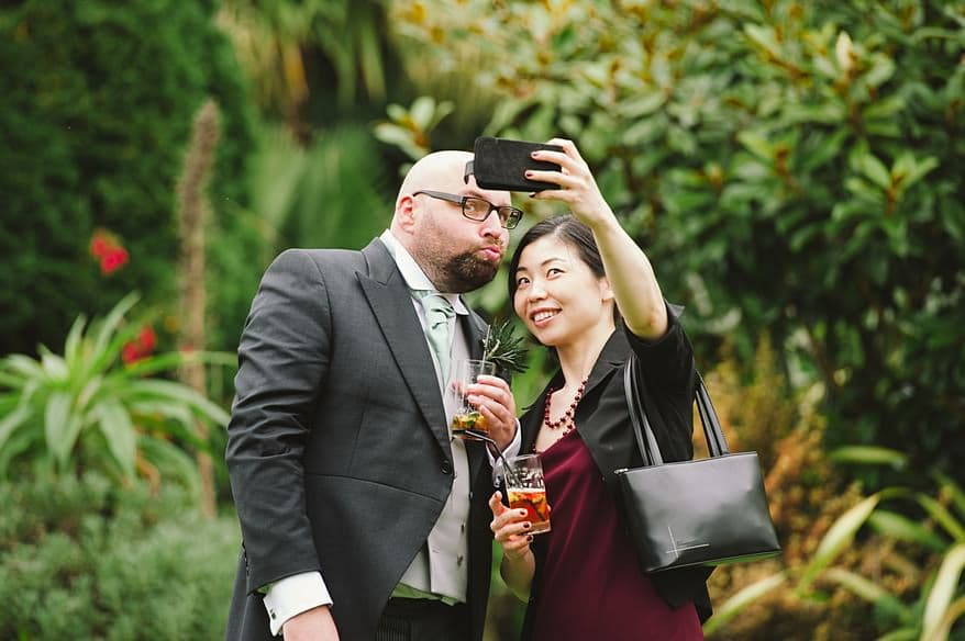 Candid shot of a couple posing for a selfie at a St Michaels Hotel wedding
