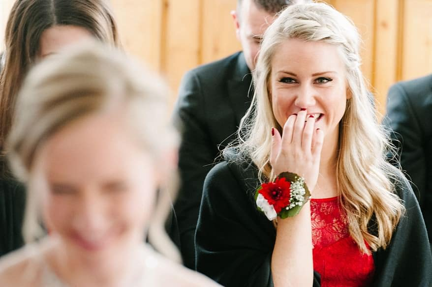 Beautiful bridemaid smiling at the bride at a wedding in Zermatt