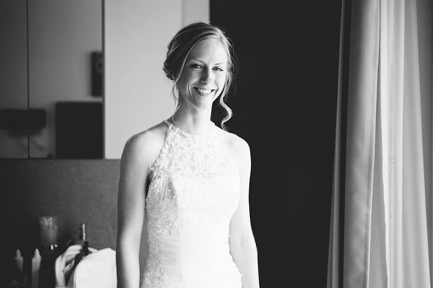 Beautiful bride in black and white in the bridal suite in Zermatt