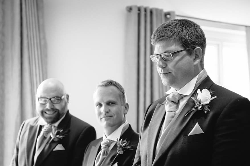 Groomsmen smiling at a nervous groom at a St Michaels Hotel wedding