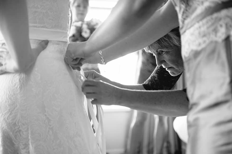 Mother of the bride tying the wedding dress at a St Michaels Hotel wedding