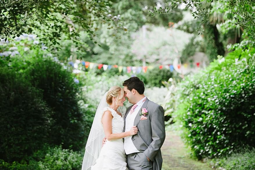 Happy bride and groom in the gardens of the Falmouth Hotel