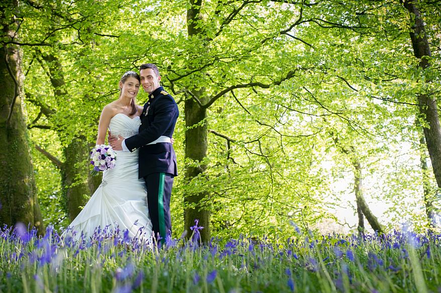Bride and groom stood in beautiful blue bells at a Trevenna Barns wedding
