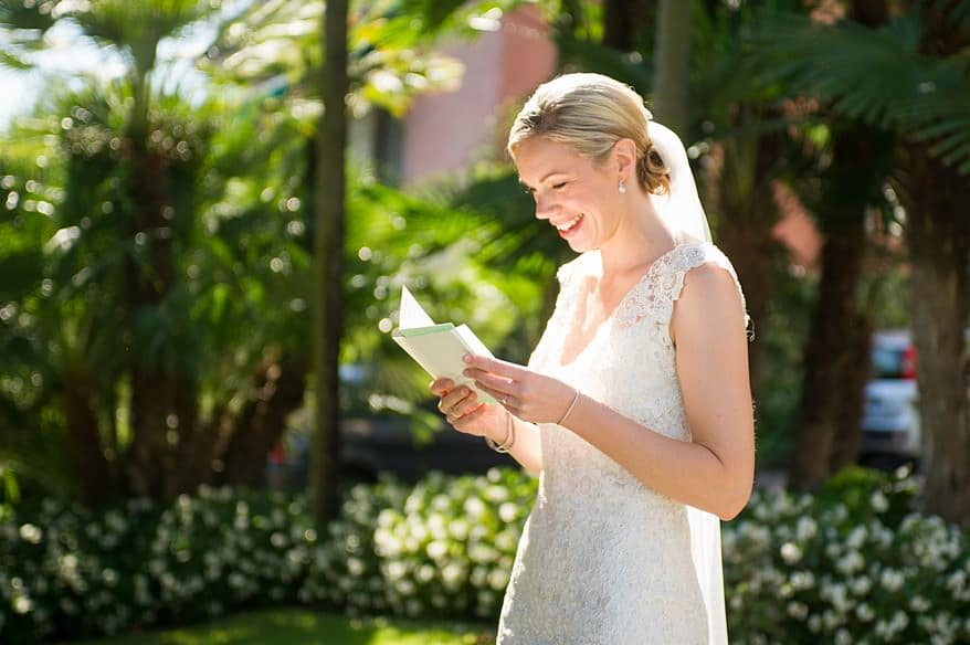 A beautiful bride reading a letter from the groom before the wedding