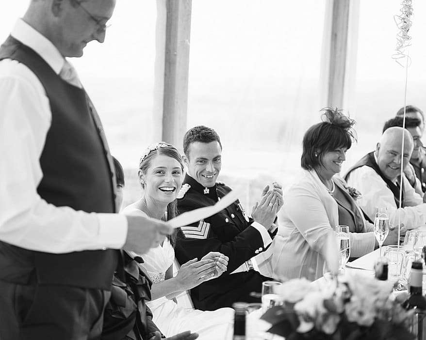 Trevenna barns head table with bride laughing