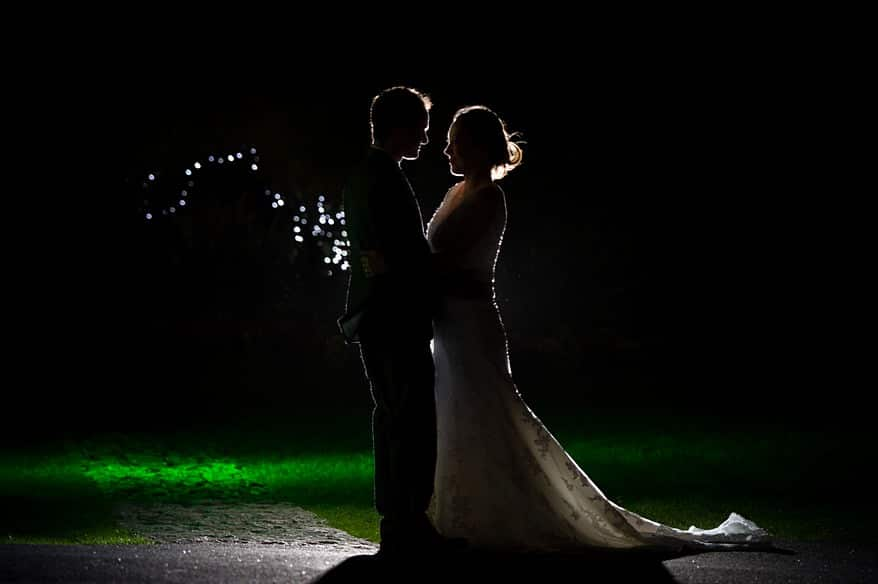 bride and groom stood on the lawn in the evening at Carbis Bay hotel