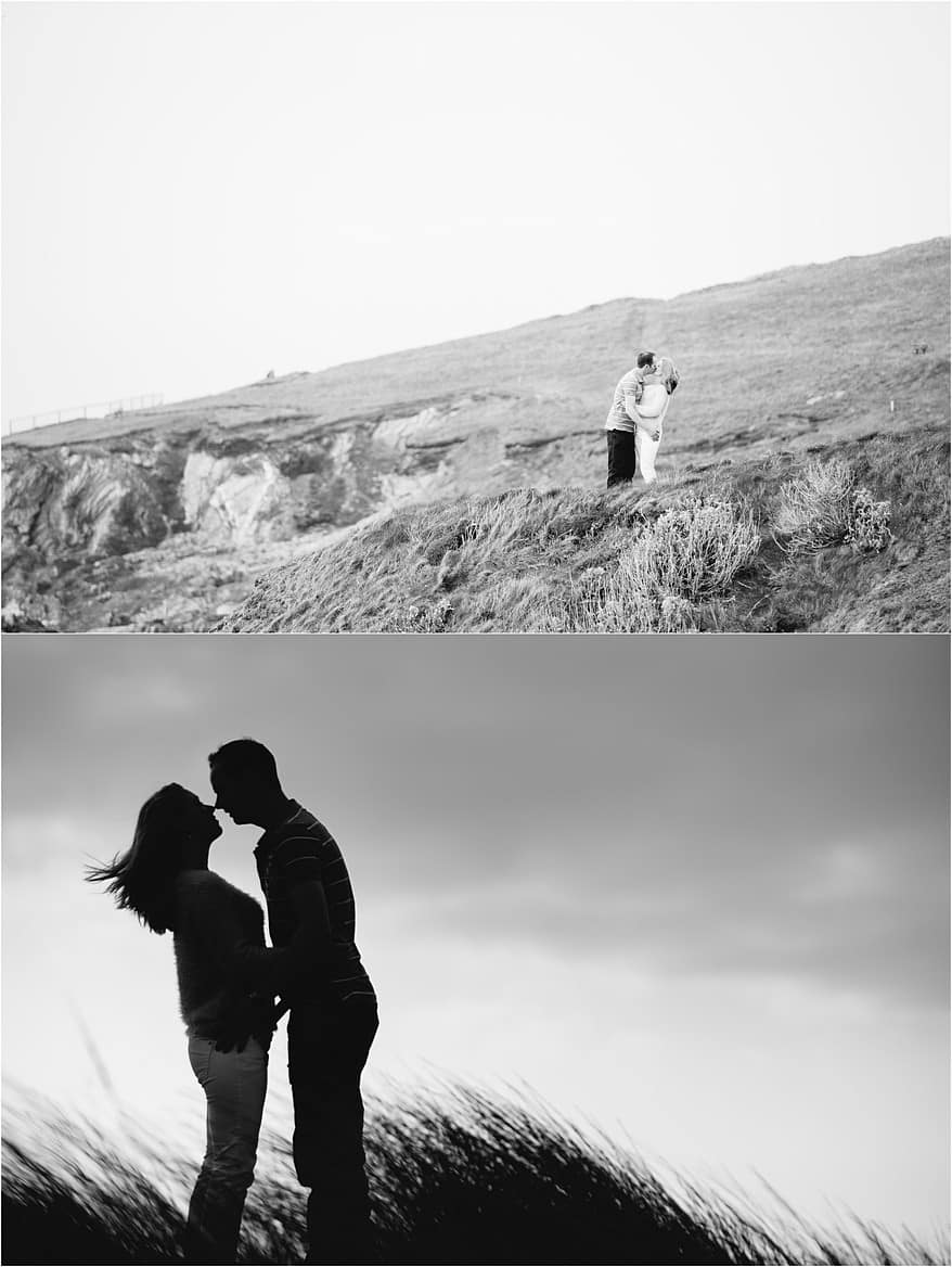 black and white photograph of a couple stood on the cliffs at the Headland hotel