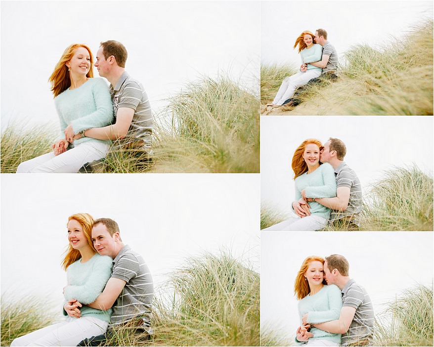 Engaged couple sat in the sand dunes at Fistal beach