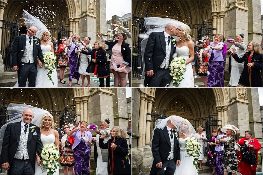 Brides Veil blowing while the confetti being thrown at Truro Cathedral