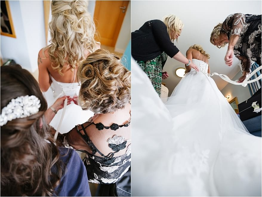 Bride getting her dress on in the honeymoon suite at St Michael's Hotel