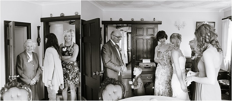 Black and white of the father first seeing his daughter in her dress