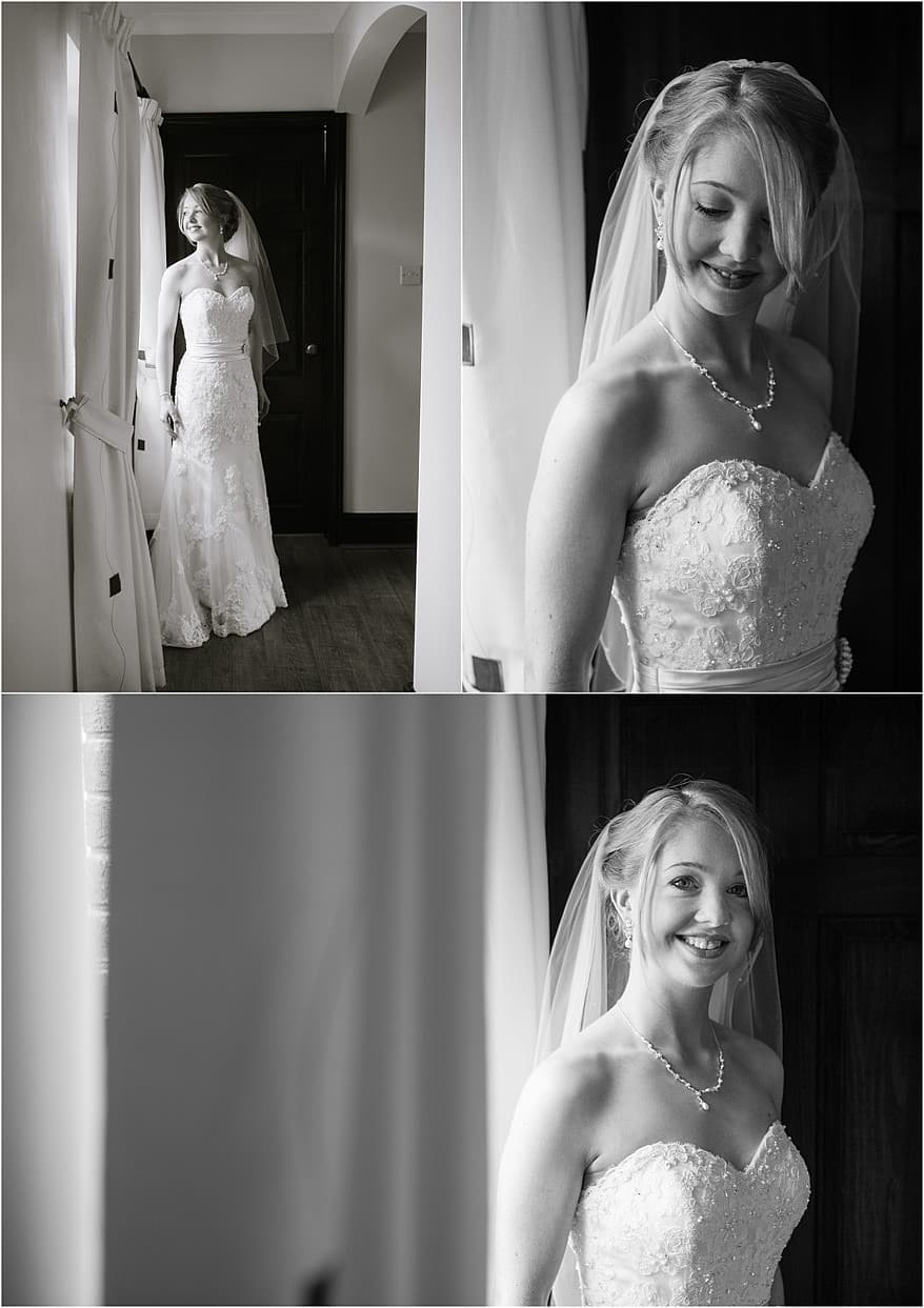 Beautiful black and white photograph of the bride in the window