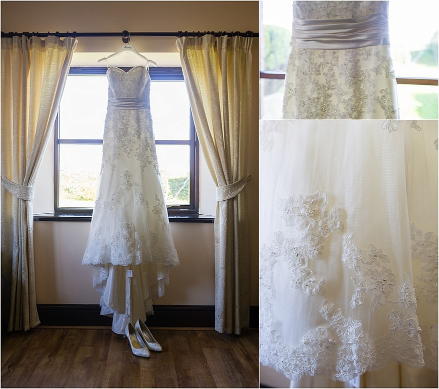 Wedding dress hanging in the window with a close up of the lace