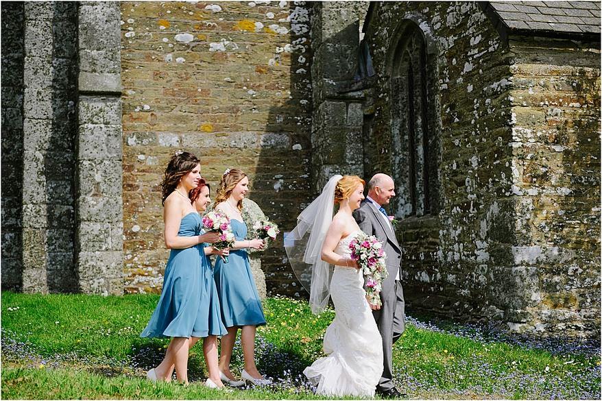 Bride walking down the path of St Allen Church
