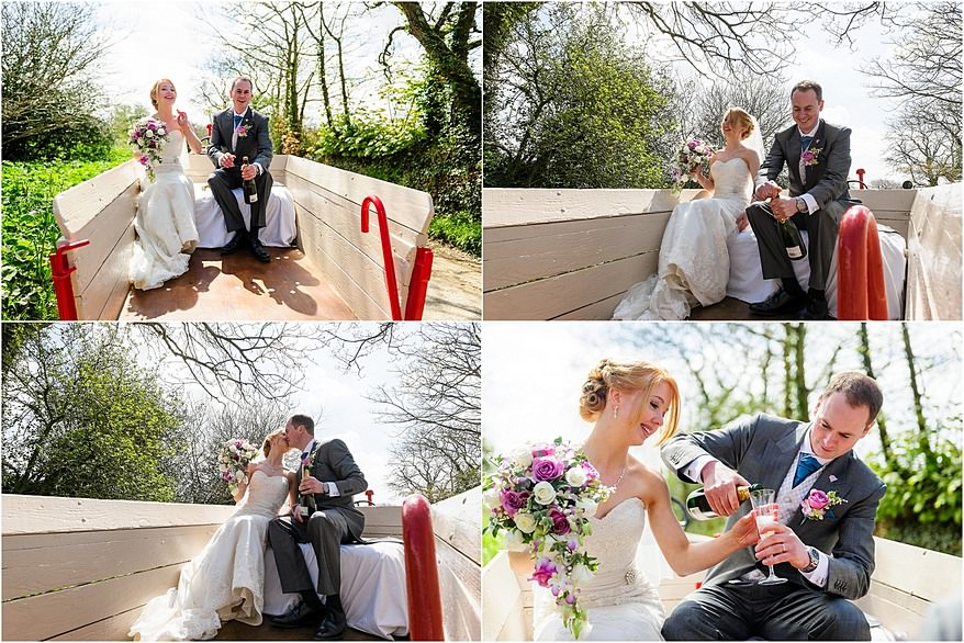 Bride and groom enjoying champagne in the wedding cart