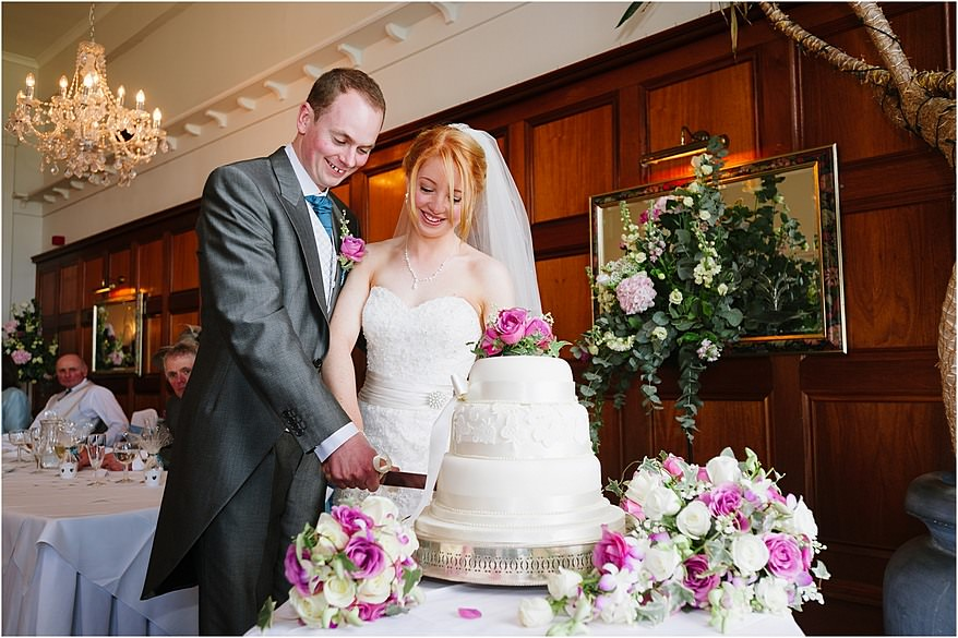 Bride and groom cutting the cake at the Atlantic hotel