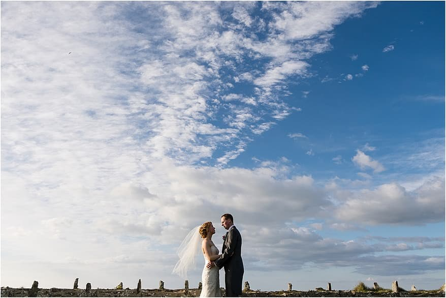Bride and groom on the lawn at the Alantic Hotel
