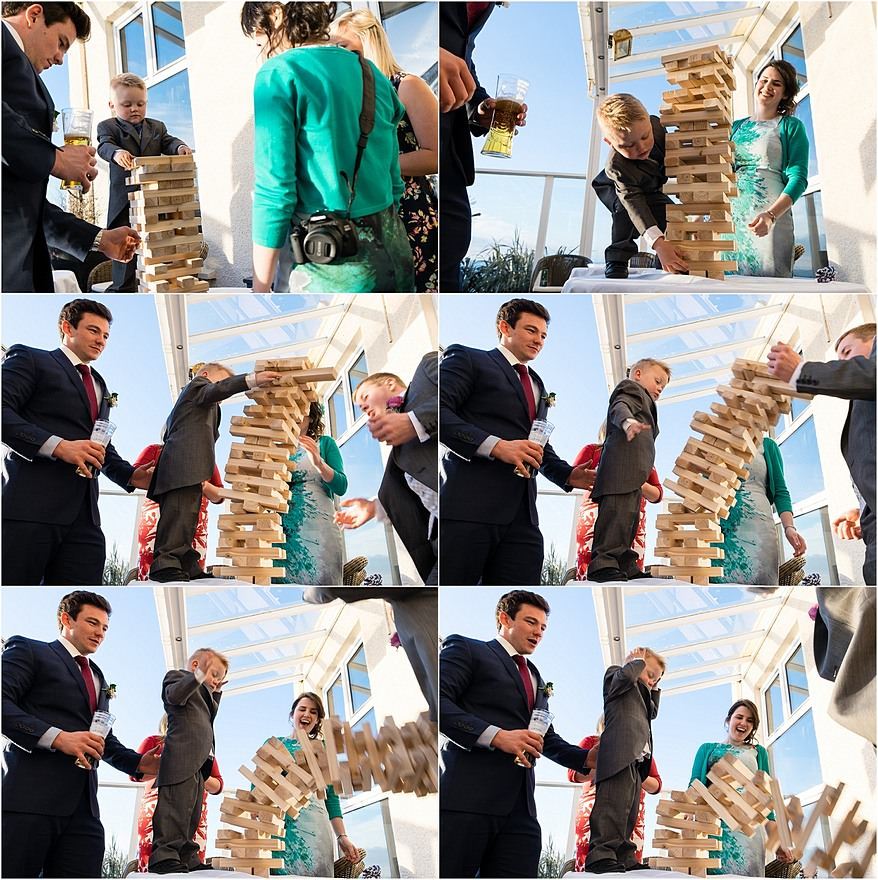 wedding guest at the Atlantic Hotel playing giant Jenga