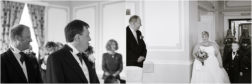 groom looking at the bride coming down the isle in the Godrevy Room