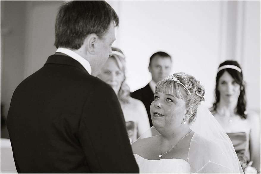 Bride gazing at the groom in the Godrevy Room at Tregenna Castle