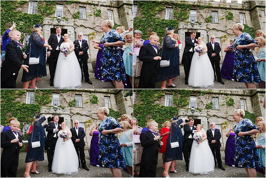 Guest throwing confetti outside the enterance of Tregenna Castle