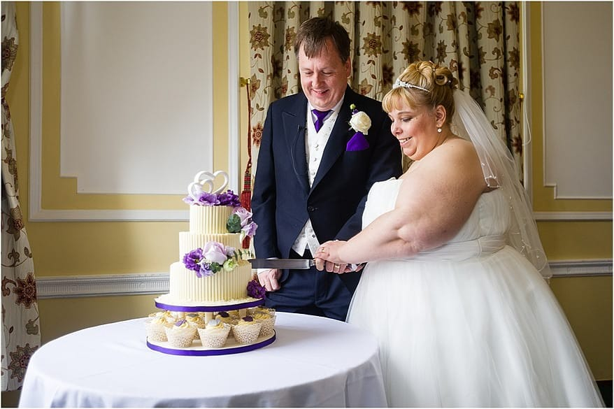Bride and groom cutting the cake at Tregenna castle