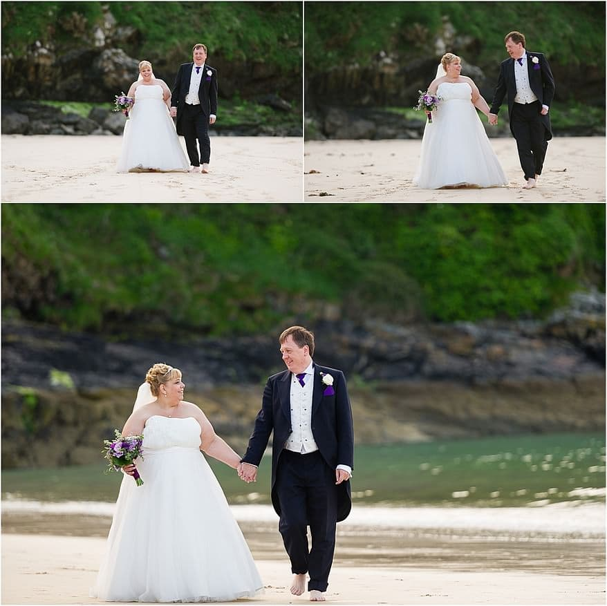 Brides and groom walking on the beach at Carbis bay