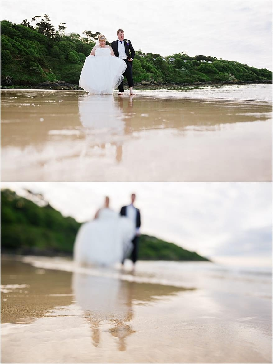 Bride and groom paddling in the sea at Carbis Bay Hotel's Beach