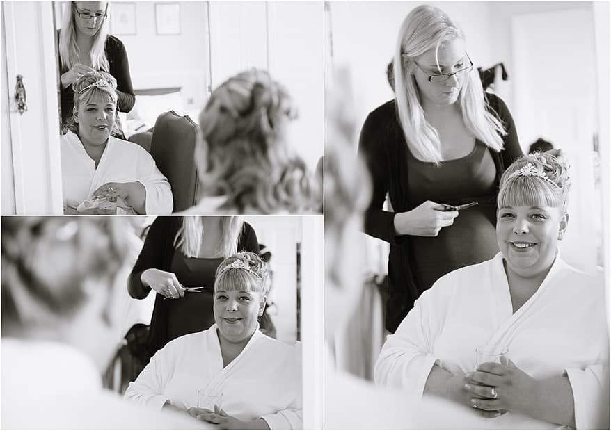 Black and white photographs of the bride having her hair styled at Tregenna Castle