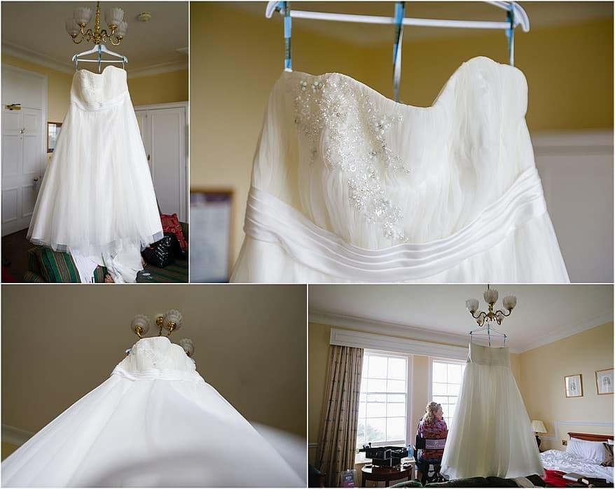 Brides wedding dress hanging in a hotel room at Tregenna Hotel
