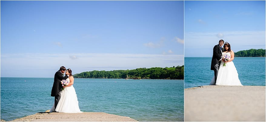 Bride and groom on the beach slipway at their wedding at Trebah Gardens