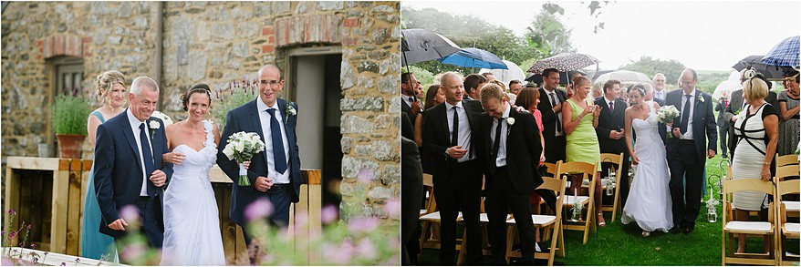 wet wedding guests at trevenna barns wedding ceremony