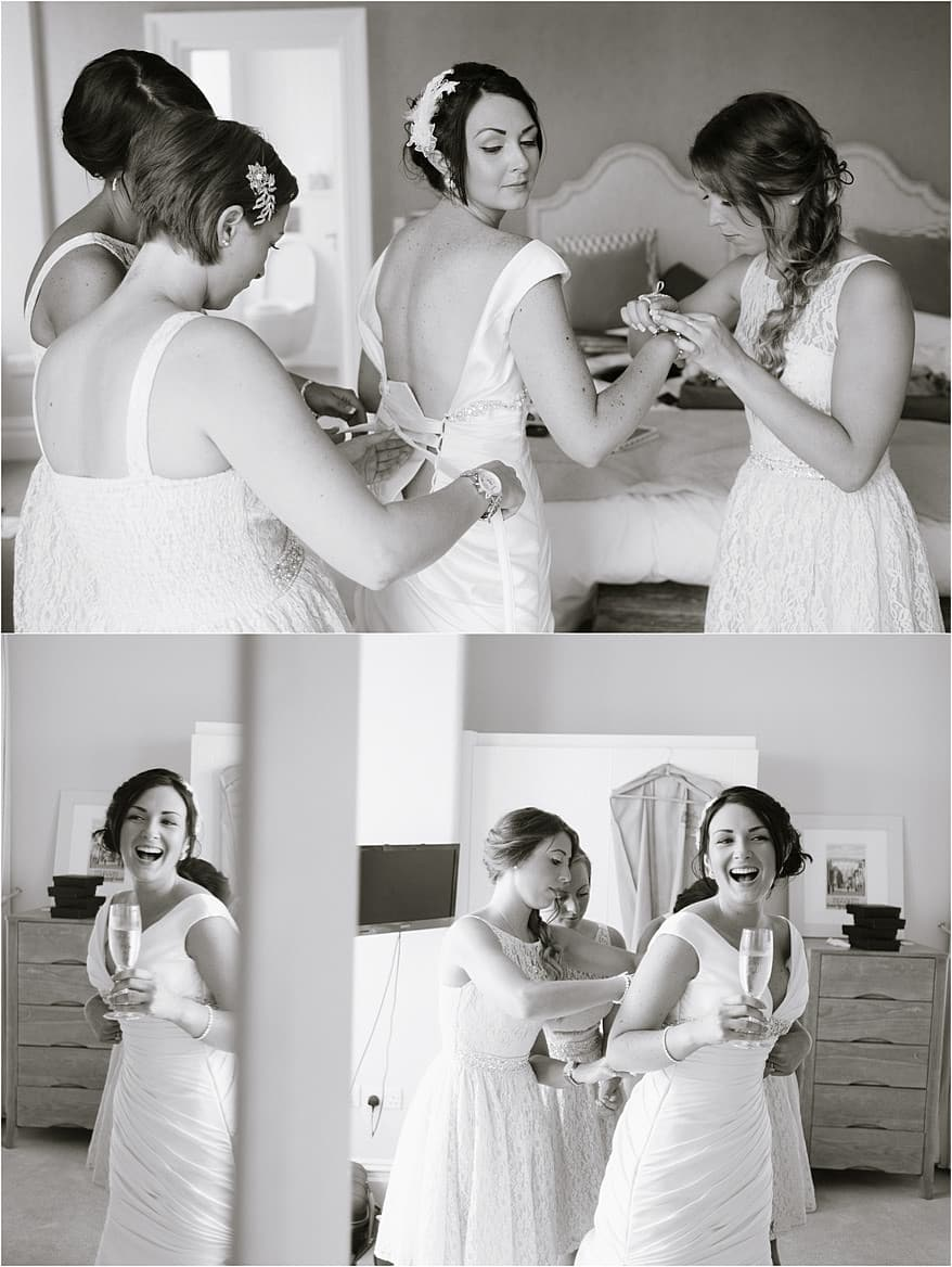 Bride getting in her wedding dress for her St Ives Harbour Hotel Wedding